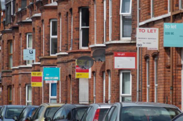 "Photo of terraced houses with ""to let"" signs attached"