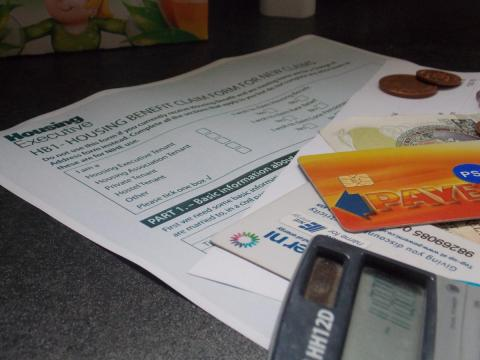 Image of housing benefit application form and electricity meter cards
